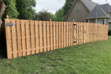6' tall cedar shadow box fence with French Gothic posts