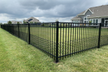 Ornamental Montage Majestic steel fence with 2' tall black vinyl chain link puppy border